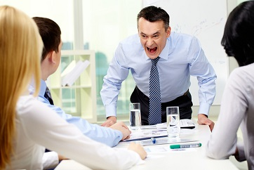 Boss shouting at employees in an office