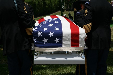 Funeral of an American soldier with flag over the coffin