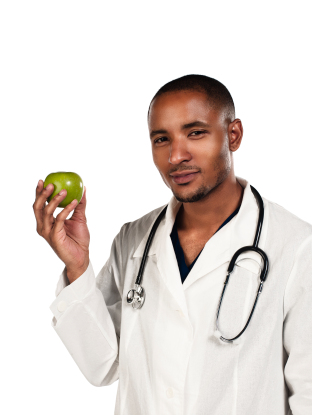 Doctor holding a green apple in his hand.