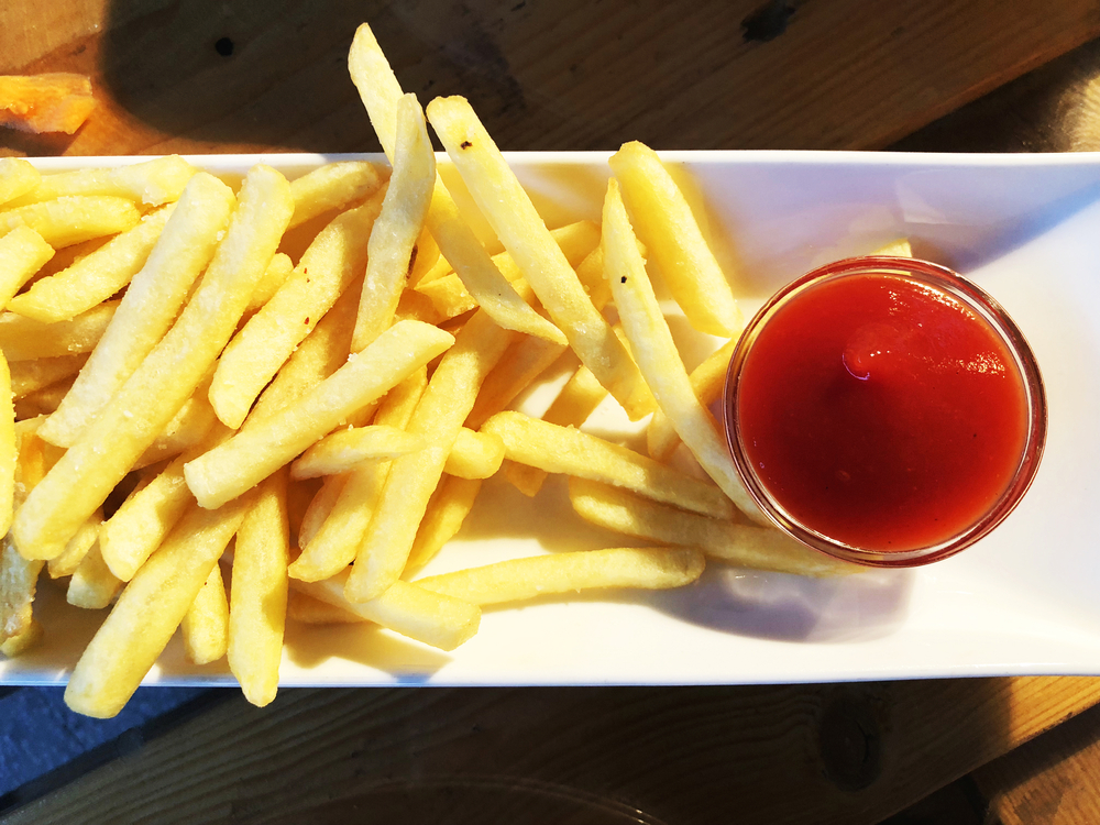 Potato free and ketchup food on the wooden table. Georgian cuisine.